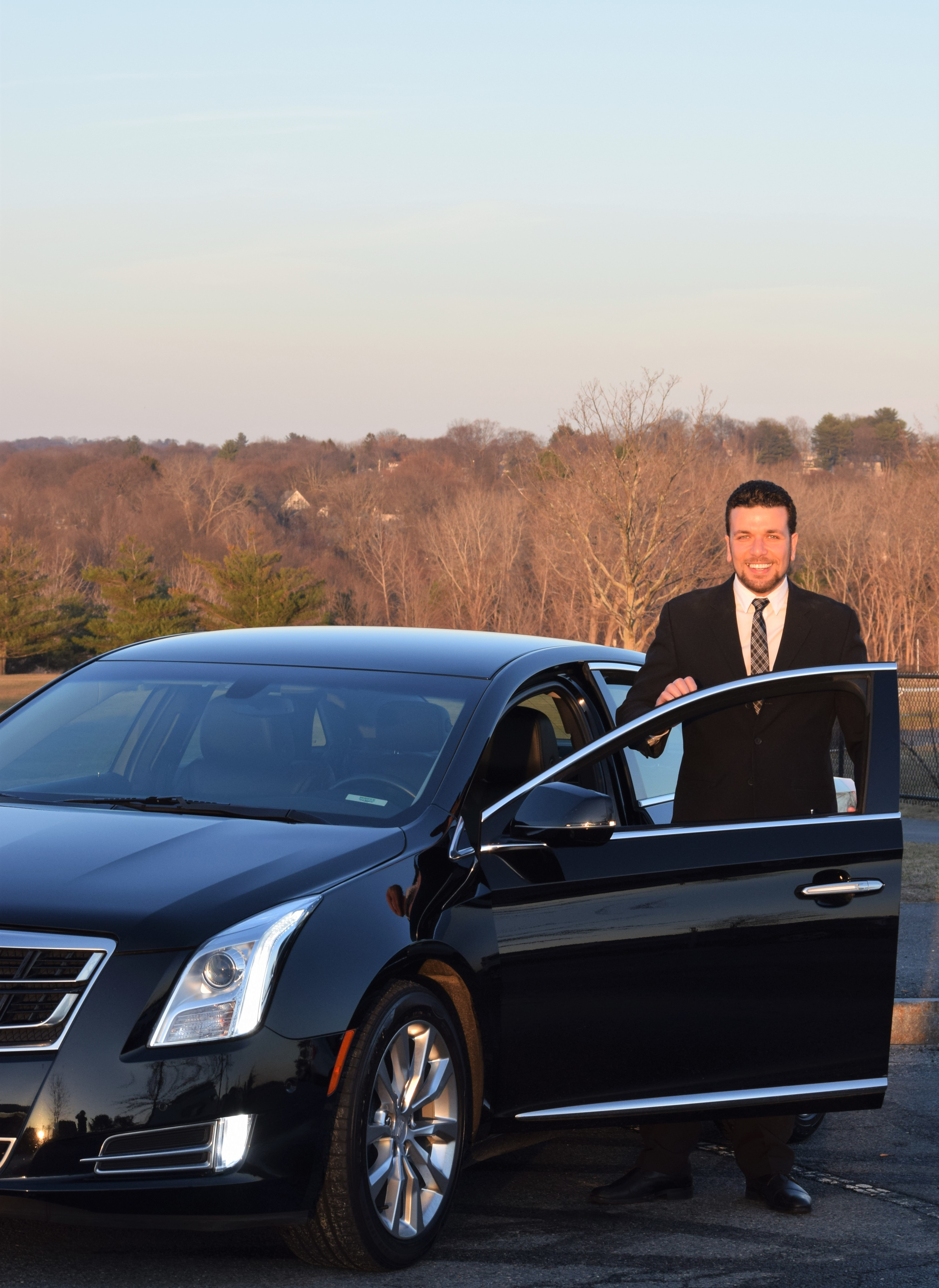 cadillac_car_black_airport_boston_logan_limo_transportation_corporate_tfgreen_newton_wellesley_weston_luxury_account